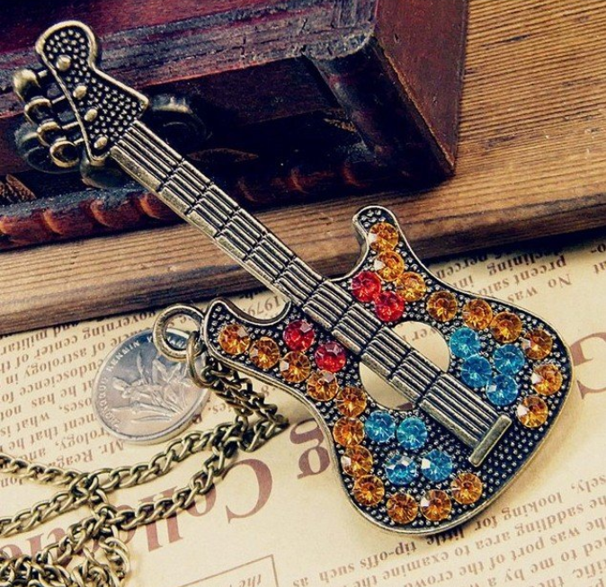Win 1 of 5 CRYSTAL Guitar Necklaces